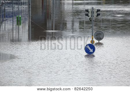 PRAGUE, CZECH REPUBLIC - JUNE 4, 2013: Flooded crossroad with traffic lights and a keep right traffic sign partially flooded by the swollen Vltava River in Prague, Czech Republic.