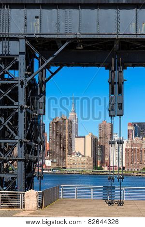 Manhattan New York skyline sunny from East River floodgates structure USA