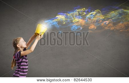 Cute girl with bucket and colorful springs coming out