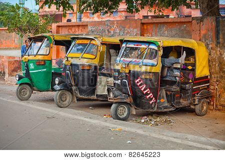 Agra, India - Circa Nov 2012: Three, Colorfully Painted, Motorized Rickshaws, Parked In The Shade On