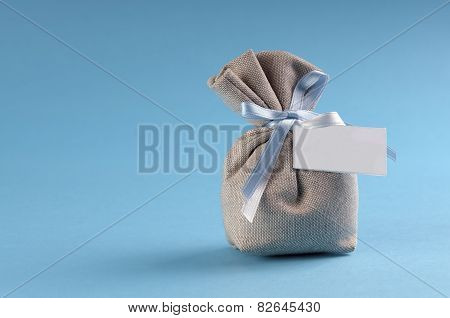 Bag With Sugared Almonds For A New Birth With Copyspace
