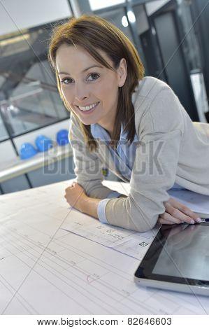 Woman engineer working on digital tablet