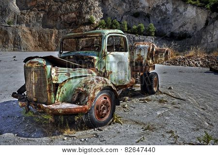 Rusty vintage broken car