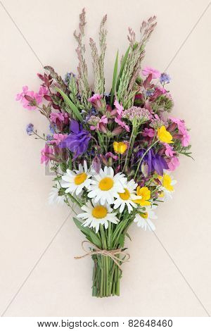 Summer wild flower posy over mottled cream background.