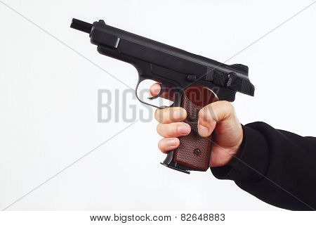 Hand with discharged semi-automatic gun on white background