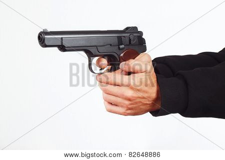 Hands with army pistol on white background