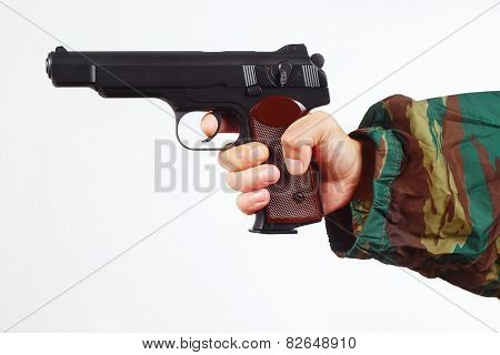Hand in camouflage uniform with army gun