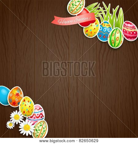 Easter colored eggs on wood background with copy space.