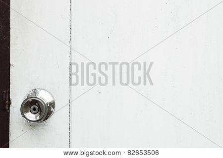 Alloy Metal Door Knob On A White Wooden Door