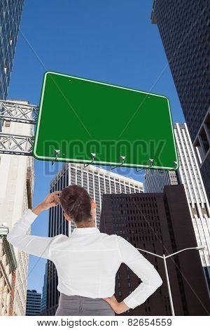 Businesswoman scratching her head against new york