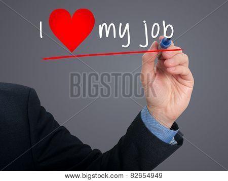 Businessman writing I love my job with heart shape - Stock image