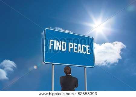 The word find peace and thinking businessman against sky