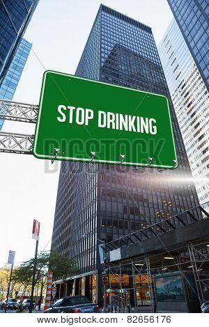 The word stop drinking and green billboard sign against skyscraper in city