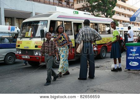 Townspeople Waiting For Public Transport On Bus Stop.