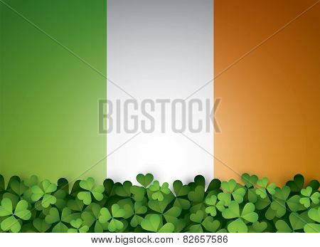 Green clover leaves and Irish flag