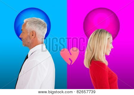Couple not talking with broken heart between them against pink and blue