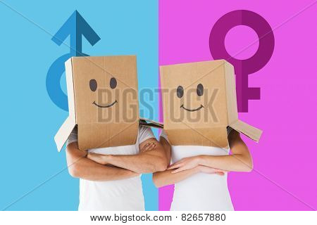 Couple wearing smiley face boxes on their heads against female gender symbol