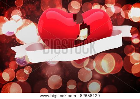 Broken heart against twinkling red and orange lights