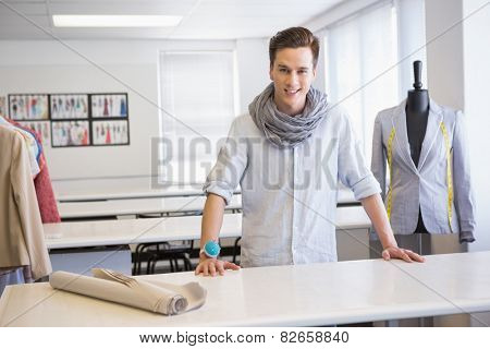 Smiling student posing in classroom at the college