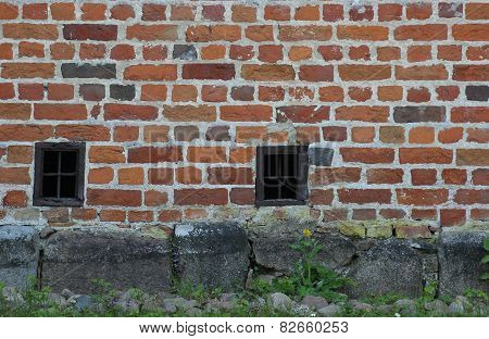 Red Brick Wall With Small Windows