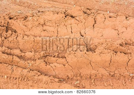 Traces of driving wheels running through on the red soil road