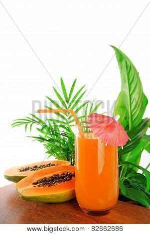 papaya fruit and glass of juice