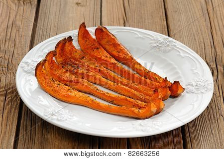 Roasted Butternut Squash In White Plate On Wooden Background