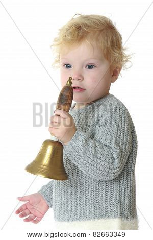 Close-up of a little girl rings the bell.