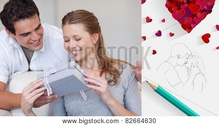 Woman opening the gift she got from her boyfriend against sketch of kissing couple with pencil