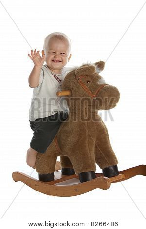 Cute Baby Boy On Rocking Horse