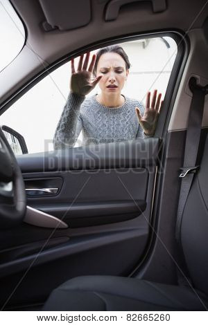 Sad woman looking inside the car