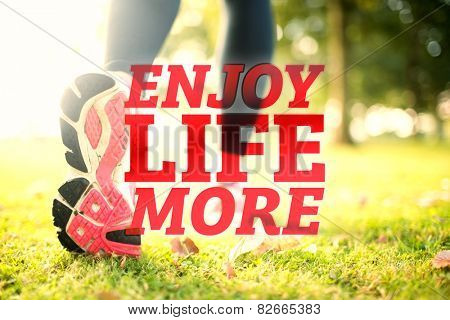 Close up picture of pink sole from running shoe against enjoy life more