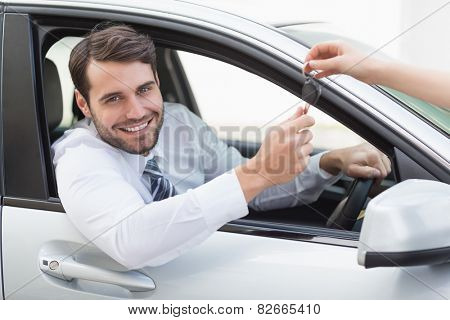 Businessman sitting in drivers seat in his car