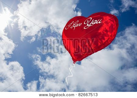 i love you against bright blue sky with clouds