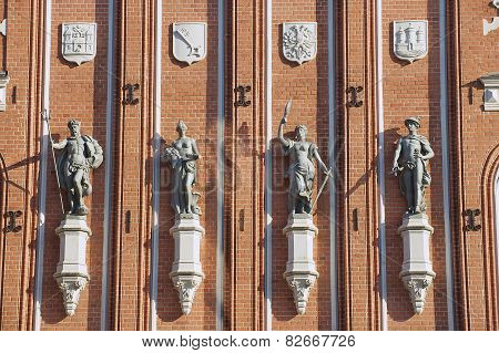 Exterior wall of the House of Blackheads with statues and coats of arms in Riga, Latvia.