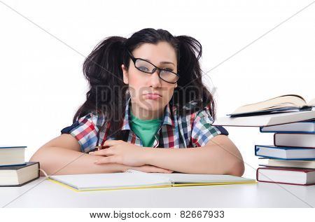 Tired student with textbooks on white