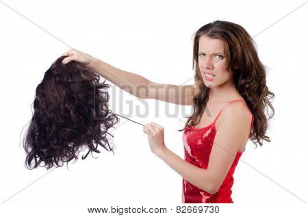 Woman with a selection of wig isolated on white
