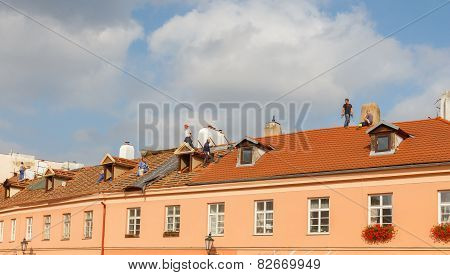 Roofers On The Roof.