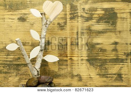 Background spruce wood with wooden heart