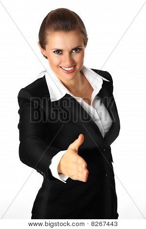 modern business woman stretches out hand for handshake