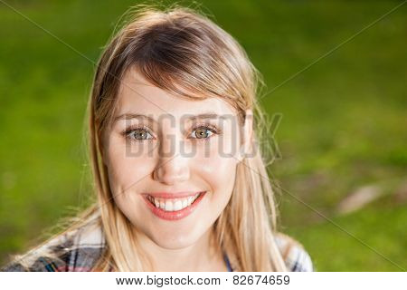 Closeup portrait of happy young woman at campsite