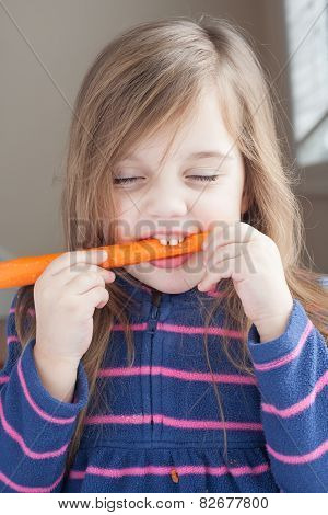 Little Girl With A Long Carrot