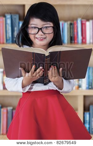 Beautiful Girl With Book In Library