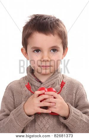 young boy holding red heart