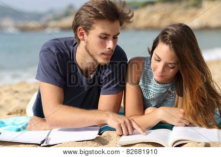 Teenager Couple Or Friends Students Studying On The Beach