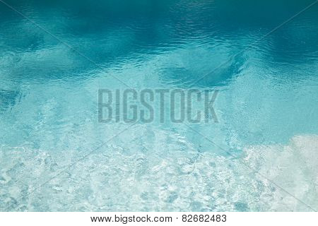 ocean, sea, travel, vacation and background concept - water in pool, sea or ocean