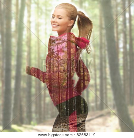 people, sport, fitness, slimming and double exposure concept - happy woman running or jogging over woods background