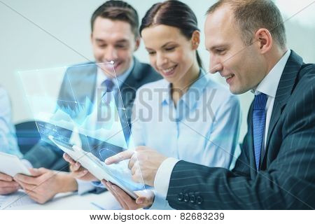 business, technology, development and people concept - smiling business team with tablet pc computer and virtual screen projection having discussion in office