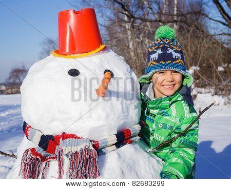 Boy with a snowman