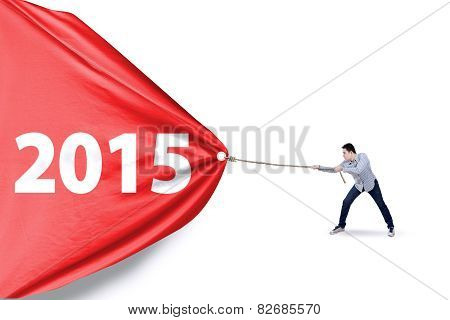 Man Dragging Number 2015 In Studio